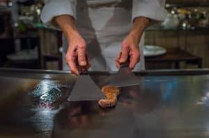 Chef Cooking Wagyu Beef In Japanese Teppanyaki Restaurant, Tokyo