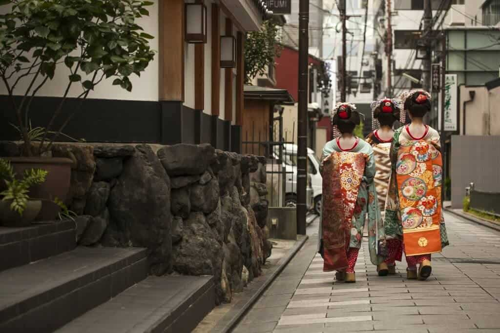 Three Geisha Walking Down the Street in Gion, Kyoto.