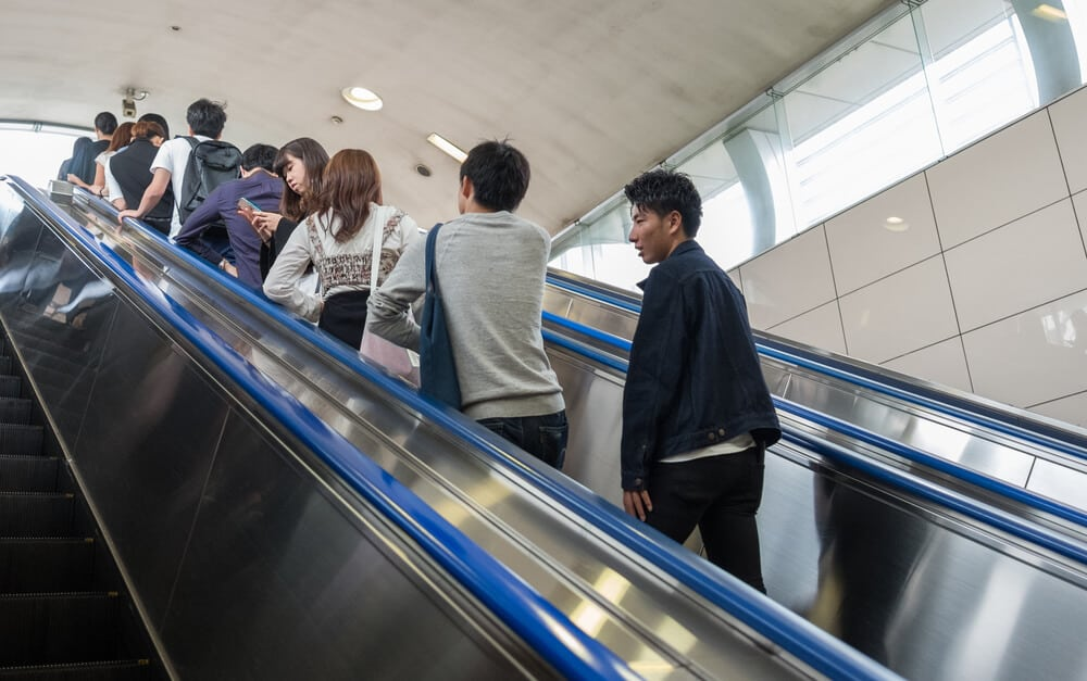 Japan Travel Guide Standing on Escalators