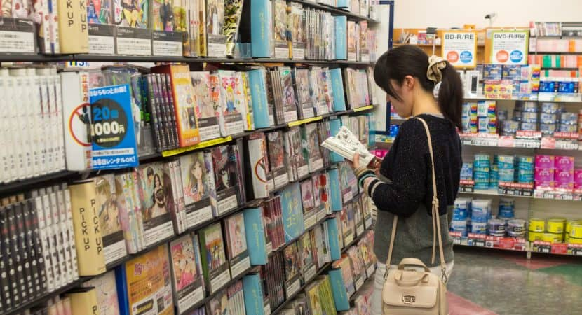 Girl Reading Manga in a Store