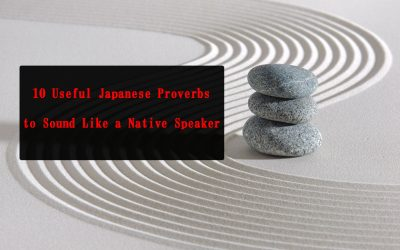 "A Zen sand garden with smooth, curved lines running through it, with three stones stacked on top of each other in the middle. The text on the images says, ""10 Useful Japanese Proverbs to Sound Like a Native Speaker."""