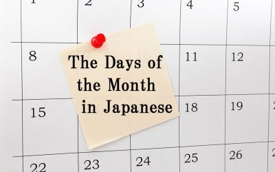"""A picture of a calendar with a pink piece of notepaper stuck in the middle of it with a red pushpin. On the note it reads, """"The Days of the Month in Japanese."""""""