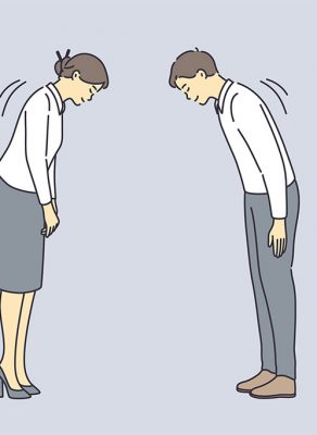 An illustration of a woman to the left and a man on the right, both wearing white shirts (woman is wearing a grey skirt and the man is wearing grey pants). They are facing each other and bowing to each other.